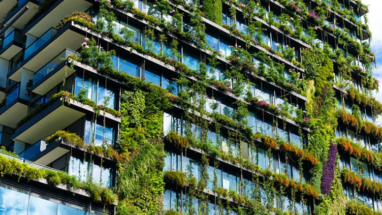 Green skyscraper building with plants growing on the facade. Ecology and green living in city, urban environment concept. Park in the sky, One central park building, Sydney, Australia; Shutterstock ID 412333285