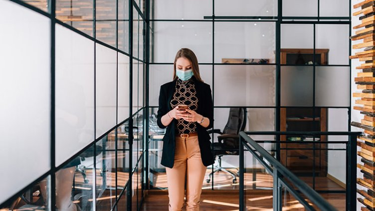 Businesswoman wearing mask in the office during COVID-19 pandemic