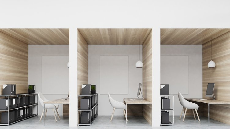 Office cubicles in an office with white and wooden walls. There are blank vertical pictures in each of them, a desk with a computer, a chair and shelves. 3d rendering mock up